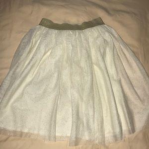 It's very cute shimmery white skirt